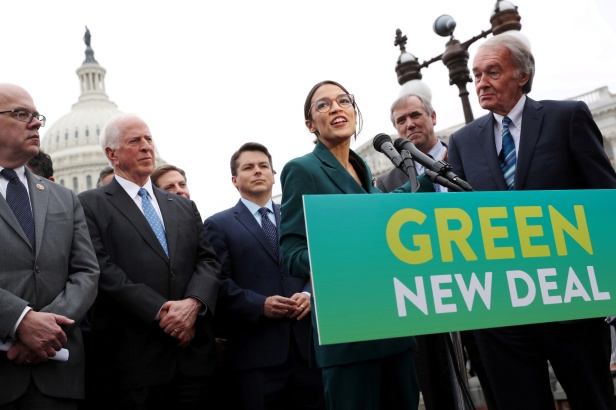 """FILE PHOTO: FILE PHOTO: U.S. Representative Ocasio-Cortez and Senator Markey hold a news conference for their proposed """"Green New Deal"""" at the U.S. Capitol in Washington"""